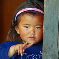 Bhutanese girl in a doorway